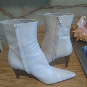 Bone White boots. Details brand.
